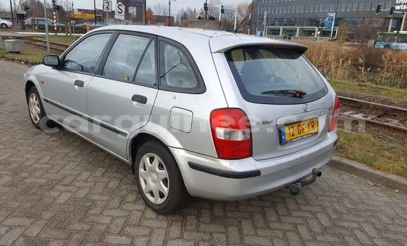 Buy Used Mazda 323 Silver Car in Conakry in Conakry