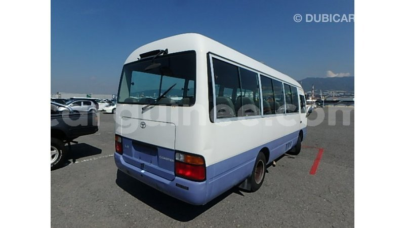 Big with watermark toyota coaster conakry import dubai 6404